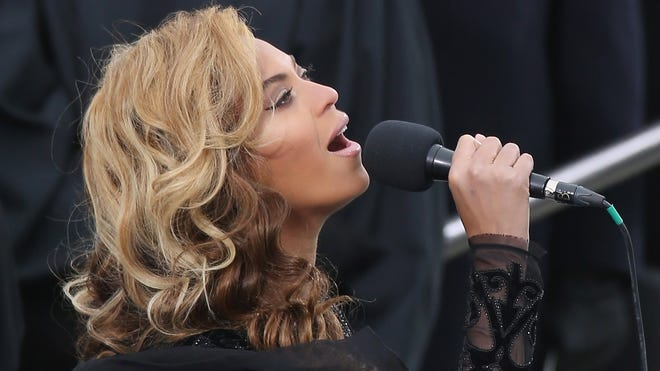 Singer Beyonce performs the National Anthem during the public ceremonial inauguration for U.S. President Barack Obama on the West Front of the U.S. Capitol January 21, 2013 in Washington, DC.   Barack Obama was re-elected for a second term as President of the United States.  (Photo by John Moore/Getty Images)