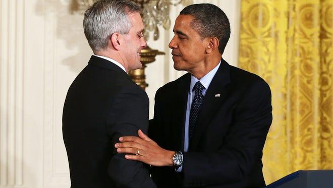 President Obama congratulates Denis McDonough.