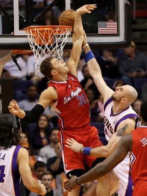 Suns center Marcin Gortat goes up for a layup against Clippers forward Blake Griffin during Thursday's 93-88 win.