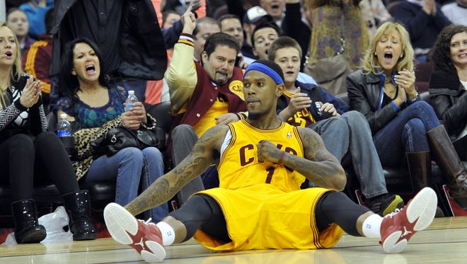 Cavaliers guard Daniel Gibson celebrates with fans after a three-pointer in Friday's 113-108 win vs. the Bucks.