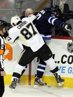 Penguins center Sidney Crosby hits Jets forward Olli Jokinen during Friday's 4-2 Winnipeg win.