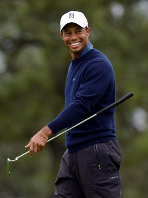 Jan 25, 2013; San Diego, CA, USA; Tiger Woods smiles on the 13th green during the second round of the Farmers Insurance Open at Torrey Pines. Mandatory Credit: Jake Roth-USA TODAY Sports ORG XMIT: USATSI-120012 ORIG FILE ID:  20130125_jla_ar5_433.jpg