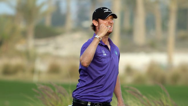 Chris Wood of England holes an eagle putt on the 18th hole to secure victory in the Commercial Bank Qatar Masters.