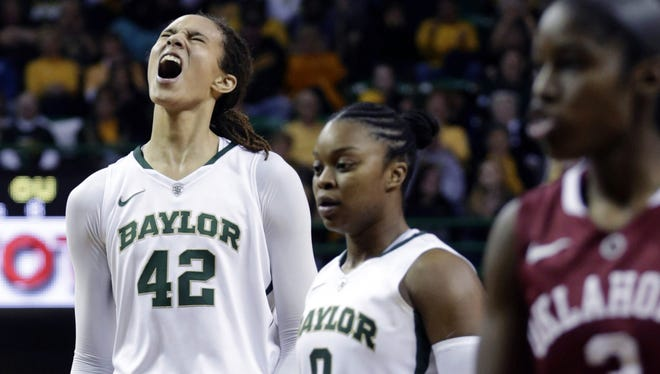 Baylor's Brittney Griner (42) celebrates after breaking the NCAA women's career record for blocks  during the second half of an NCAA college basketball game against Oklahoma on Saturday.