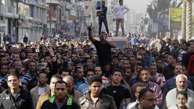 Egyptians march in a funeral procession Saturday for three people who died in demonstrations marking the second uprising anniversary in Suez, Egypt.