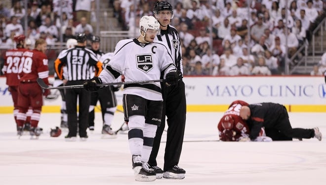 The Kings' Dustin Brown reacts alongside a referee after Brown leveled the Coyotes' Michal Rozsival in overtime of Game Five of the Western Conference Finals last season.