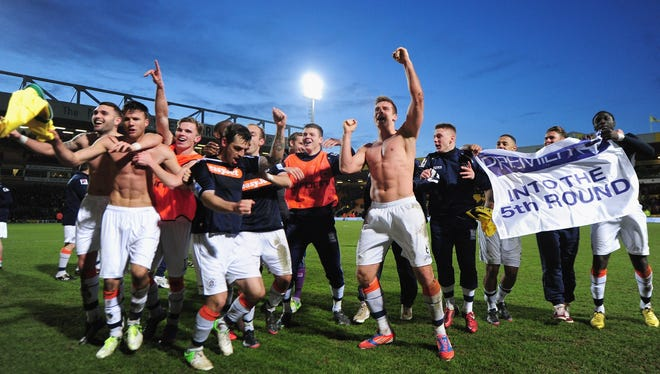 Luton Town celebrates victory over Norwich in the FA Cup.