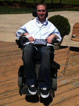 Shane Hmiel, who was told he would never breathe again on his own, let alone move his fingers or his toes, has regained feeling in his right hand. He uses it to navigate his wheelchair.