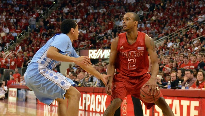 N.C.  State guard Lorenzo Brown (2), working on North Carolina guard Marcus Paige left, tallied 20 points and 11 assists in the Wolfpack's 91-83 win.