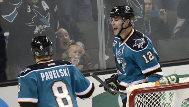 San Jose Sharks winger Patrick Marleau, right, celebrates his second goal during the first period against the Colorado Avalanche at HP Pavilion.
