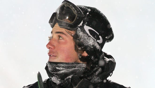 In a file photo from Jan. 19, Mark McMorris takes a look at the scoreboard after his last run at the Big Air Men's Finals at the FIS World Championships in Quebec.
