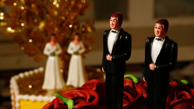 Same-sex wedding cake topper figurines are seen at Cake and Art cake decorators June 10, 2008 in West Hollywood, California.