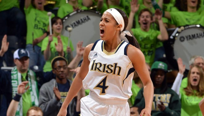 Notre Dame Fighting Irish guard Skylar Diggins (4) reacts after a three-point basket in the first half against the Providence Friars at the Purcell Pavilion. Diggins went over the 2,000-point mark in the first half of the game.