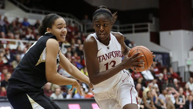 Stanford's Chiney Ogwumike (13) dribbles past Colorado's Jamee Swan during the second half of an NCAA college basketball game in Stanford, Calif.
