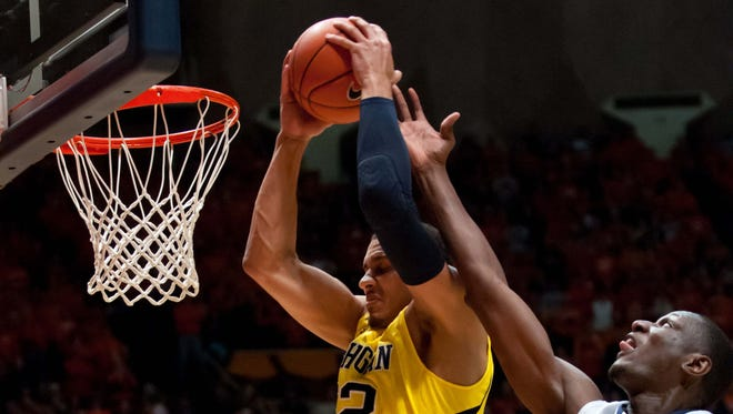 Michigan Wolverines forward Jordan Morgan (52) rebounds the ball over Illinois Fighting Illini center Nnanna Egwu (32) during the first half at Assembly Hall.