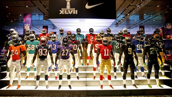 A team of mannequins show off at the NFL Shop at the Convention Center in New Orleans.