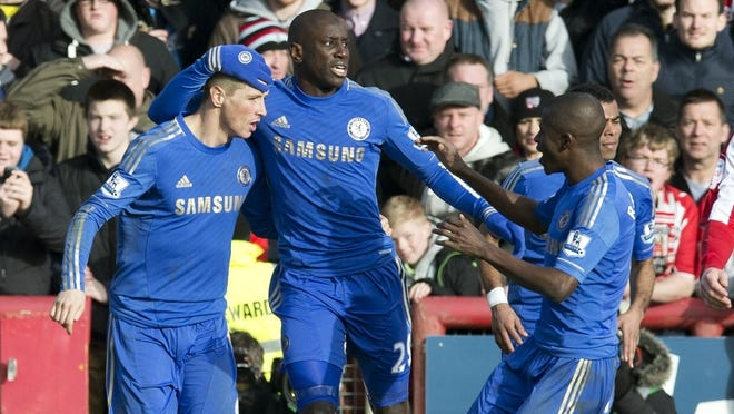 Chelsea striker Fernando Torres (L) celebrates after scoring his late goal in a 2-2 draw.