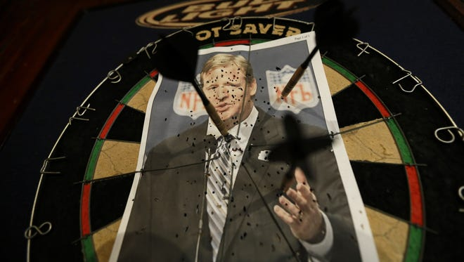 A photo of NFL commissioner Roger Goodell is seen on a dartboard inside the Parkview Tavern in New Orleans. New Orleans is celebrating the return of Saints coach Sean Payton, but the good feeling does not extend to Goodell, who suspended Payton and other key players and coaches last year for the bounty scandal.