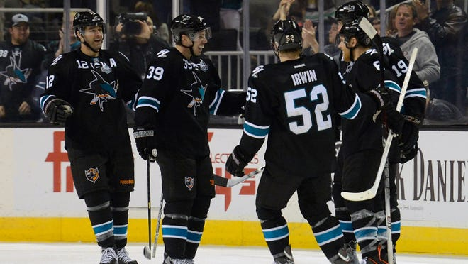The San Jose Sharks celebrate after Joe Pavelski scored his 2nd goal against the Vancouver Canucks  on Jan. 27, 2013 in San Jose, Calif. The Sharks won the game 4-1.