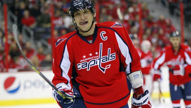 Washington Capitals left wing Alex Ovechkin  smiles in the closing seconds of the third period against the Buffalo Sabres.