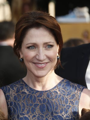 Edie Falco arrives at the Screen Actors Guild awards at the Shrine Auditorium in Los Angeles.