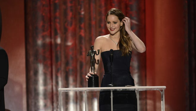 Jennifer Lawrence accepts best female actor in a leading role SAG Award at the Shrine Auditorium.
