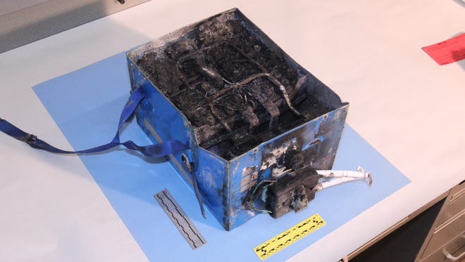 Burnt battery removed from a Japan Airlines Dreamliner at Boston's airport.
