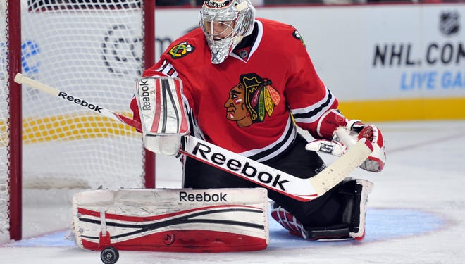 Chicago Blackhawks goalie Corey Crawford watches the puck after making a save against the Detroit Red Wings.