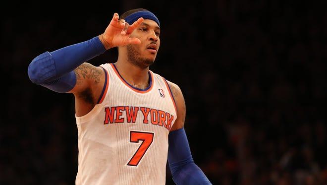 Knicks forward Carmelo Anthony celebrates a basket during Sunday's 106-104 win vs. the Hawks.