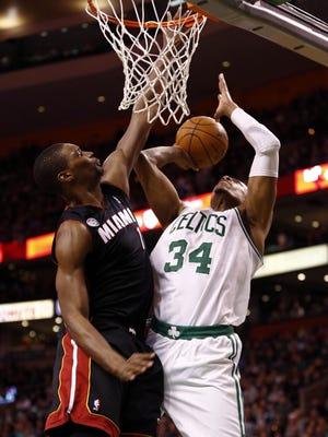 Celtics forward Paul Pierce shoots on Heat forward Chris Bosh during Sunday's 100-98 double-overtime win.