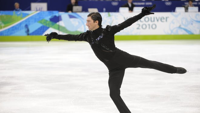 In a file photo from Feb. 16, 2010, Evan Lysacek of the USA skates in the men's short program. He won the Olympic gold.