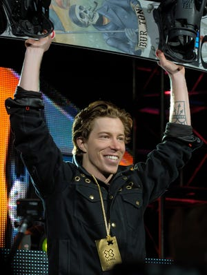 Shaun White celebrates his superpipe gold medal.