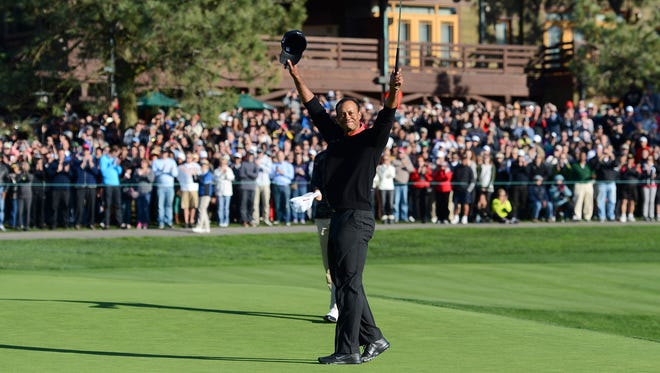 Tiger Woods celebrates his seventh victory in the Farmers Insurance Open, and his 75th career PGA Tour title.