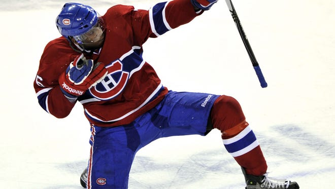 Montreal Canadiens' P.K. Subban celebrates after scoring an overtime goal in January 2011. Subban signed a two-year deal with the Canadiens.