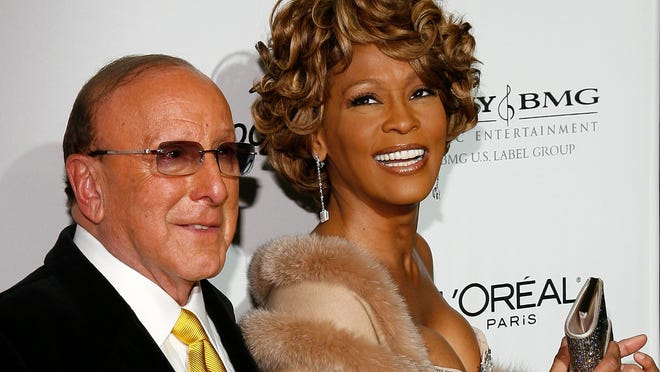 Music mogul Clive Davis and Whitney Houston arrive at the Clive Davis pre-Grammys party held at the Beverly Hilton in 2007. Houston died on Feb. 11, 2012, in the same hotel on the day the same event was to be held.