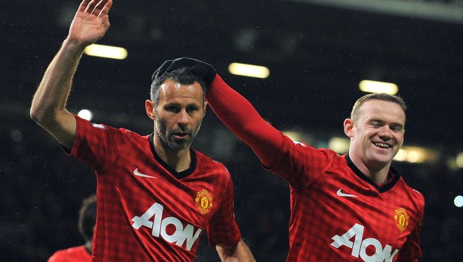 Ryan Giggs and Wayne Rooney celebrate Giggs' goal in the FA Cup match against Fulham.