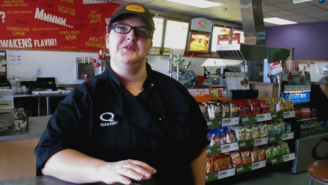 Kaylee Feight talks about the impact of a minimum wage increase on her job at Quiznos in Helena, Mont., on Dec. 28.