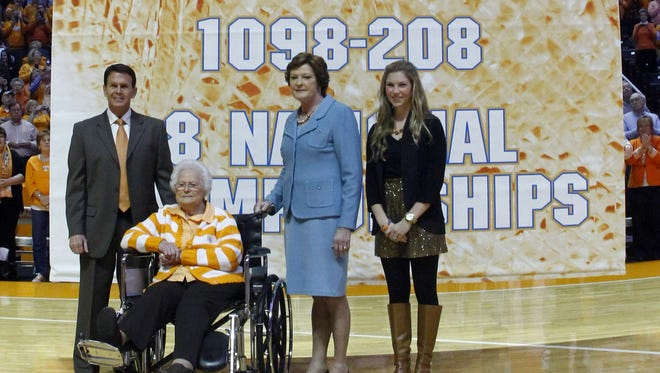 Tennessee Athletic Director Dave Hart, left, stands with head coach emeritus Pat Summitt, third from left, her mother Hazel Head, seated, and future daughter-in-law AnDe Ragsdale as a banner in Summitt's honor was raised.