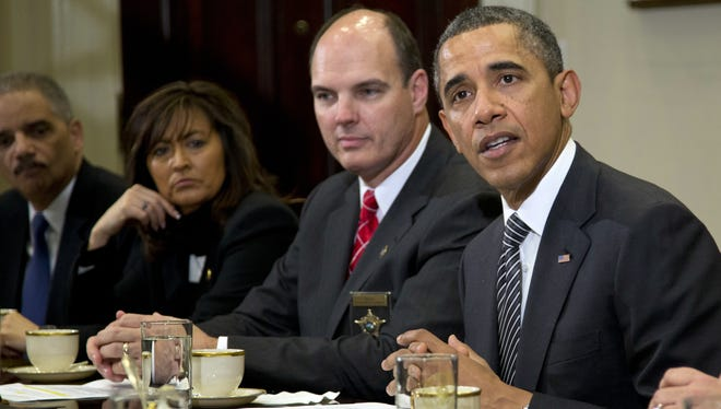 President Obama meets with law enforcement officials on Jan. 28 at the White House.