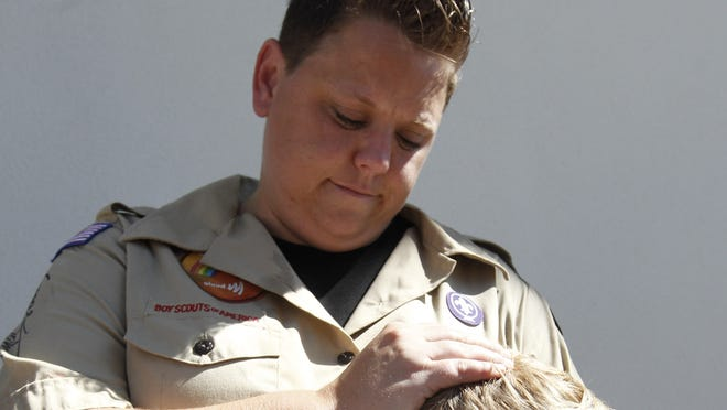In this July 18, 2012 file photo, Jennifer Tyrrell hugs her son Cruz Burns, 7, outside Boy Scouts national offices in Irving, Texas, after a meeting with representatives of the 102-year-old organization. The Ohio woman was ousted as a den mother because she is a lesbian.