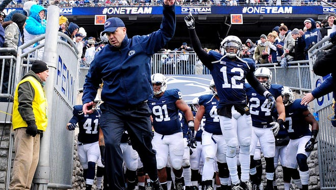 Penn State Nittany Lions head coach Bill O'Brien  leads his team out onto the field prior to the game against the Wisconsin Badgers at Beaver Stadium.