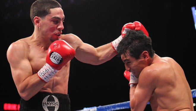Super lightweight champion Danny Garcia, left,  defeated Erik Morales in October at the Barclays Center in Brooklyn.