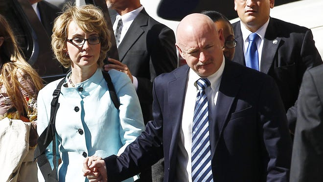Former Arizona congresswoman Gabrielle Giffords and her husband, Mark Kelly, leave after the sentencing of Jared Loughner in Tucson on Nov. 8.