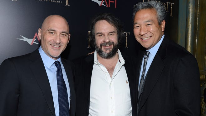 Kevin Tsujihara of Warner Bros., right, with director Peter Jackson, center,  and another studio exec, Jeff Robinov, who was also in the running for the company's top job.