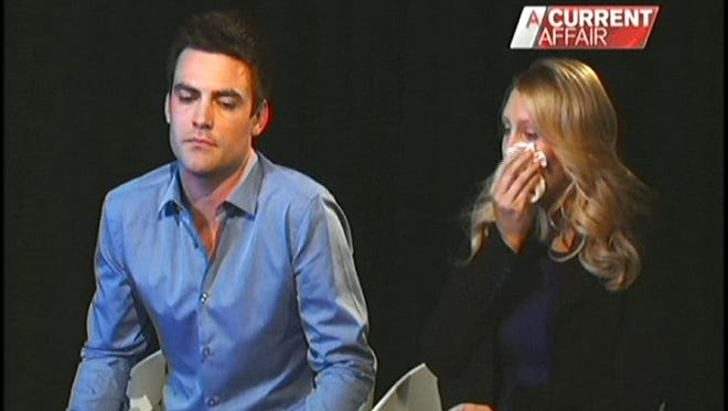 In this image of video footage of Australia's A Current Affair program, recorded Dec. 10, Australian radio hosts Michael Christian, left, and Mel Greig give an interview on Australian TV.