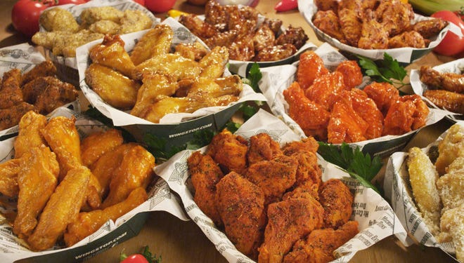 America's favorite Super Bowl munchie is in jeopardy: Chicken wing prices have flown sky high.