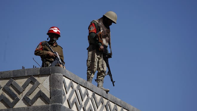 Yemeni soldiers stand guard on the rooftop of a state security court Monday during a trial of suspected al-Qaeda militants in Sanaa.