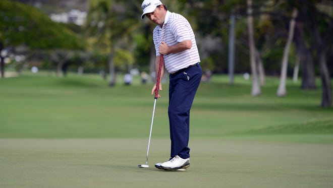 Tim Clark reacts to his putt on the 13th hole during the second round of the Sony Open at Waialae Country Club in January. Clark spoke at  a recent player's meeting to voice his support for the long putter.