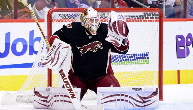 Phoenix Coyotes goalie Chad Johnson makes one of his 21 saves in the third period against the Nashville Predators. The Coyotes won 4-0.