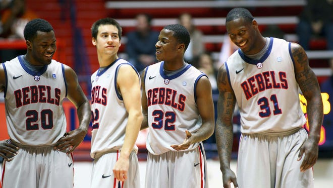 Mississippi Rebels guard Marshall Henderson (22) and his teammates all share a laugh during the team's 95-68 win against Fordham earlier this season.
